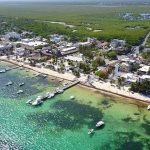the beaches, docks and prime oceanfront real estate of puerto morelos seen from the air