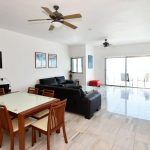 A spacious living and dining area with walk out terrace